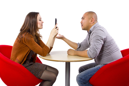 ignoring a boring date while on a cell phone photo