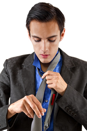 formal dressing: young male businessman getting dressed for work  Stock Photo