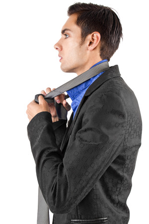 young male businessman getting dressed for work  Stock Photo