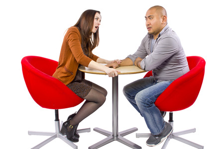 rude interracial couple on a bad date Stock Photo