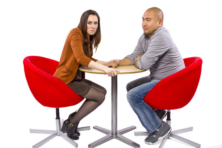 rude interracial couple on a bad date Stock Photo - 27491920