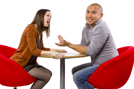 rude interracial couple on a bad date Stock Photo - 27491921