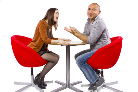 rude interracial couple on a bad date Stock Photo - 27491922