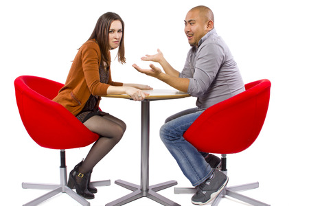 rude interracial couple on a bad date Stock Photo - 27491924