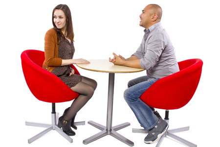 rude interracial couple on a bad date Stock Photo - 27491925