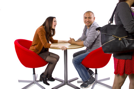 rude interracial couple on a bad date Stock Photo - 27491935