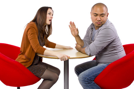 nagging: rude interracial couple on a bad date Stock Photo