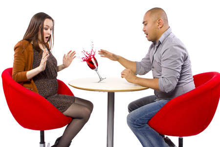 clumsy: clumsy man spilling a drink on his date