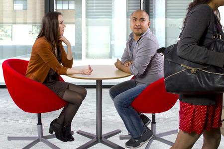 disrespectful: rude interracial couple on a bad date Stock Photo