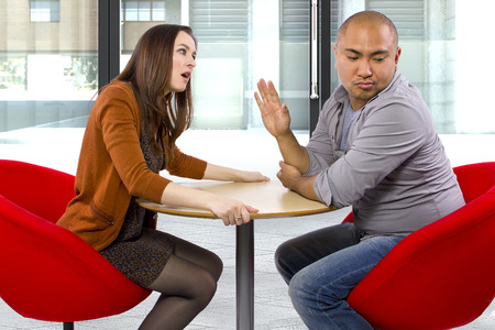 obnoxious: rude interracial couple on a bad date Stock Photo