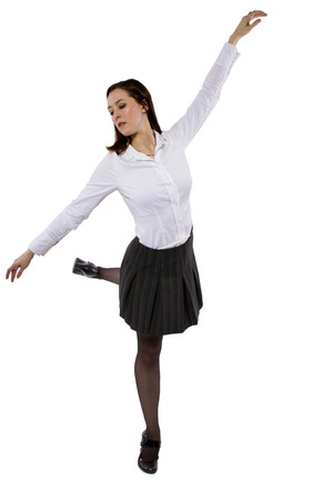 female student or businesswoman balancing on one foot photo