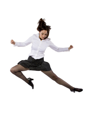 student or businesswoman leaping in a ballet form photo