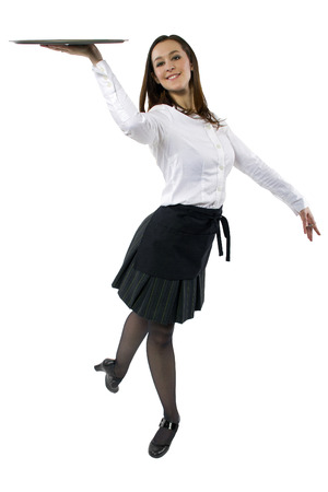 young female waitress dancing and carrying an empty tray photo