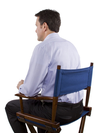 filmmaker: male casting director sitting on a folding chair Stock Photo