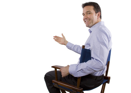 male casting director sitting on a folding chair Stock Photo - 27976134