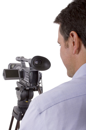 filmmaker: casting director sitting and recording auditions with camera