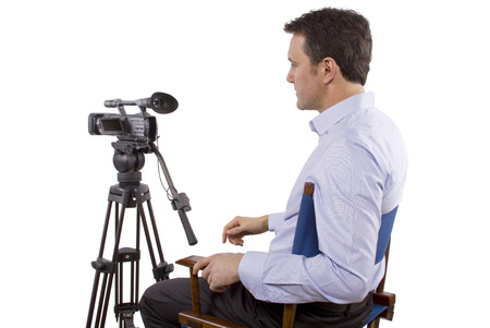 casting director sitting and recording auditions with camera Stock Photo - 27976205