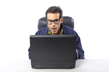 casually dressed man with glasses browsing the internet Stock Photo - 27976029