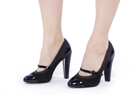 stepping: closeup of female legs stepping or stomping with high heels