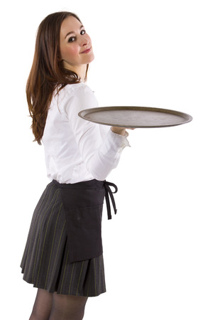 young female waitress holding blank tray for composites Foto de archivo