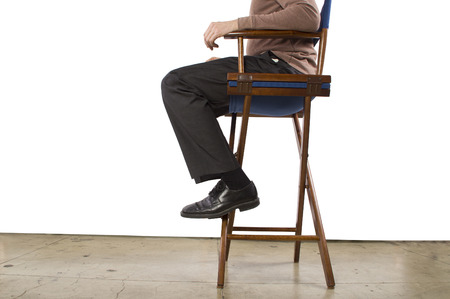 low crop of sitting Hollywood producer for copyspace photo