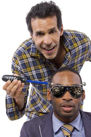 unorthodox: mechanic or handyman fixing loose screws on male head