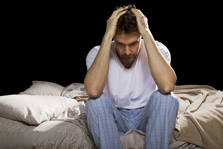young man unable sleep because of stress of problems photo