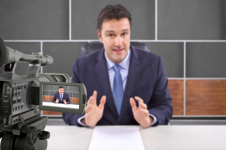 host: tv studio camera recording male reporter or anchorman Stock Photo