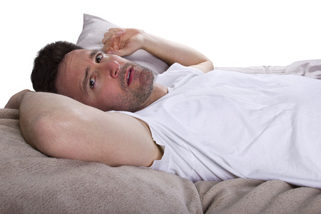 sleep: close up of insomniac unable to sleep in bed Stock Photo