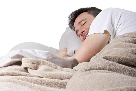 man peacefully sleeping in a quiet bedroom