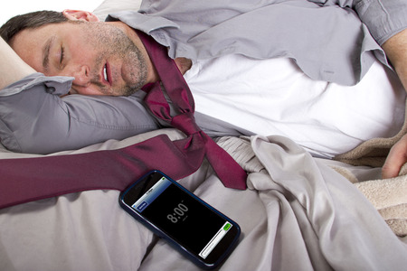 tardy employee unable to wake up in time to get to work Banco de Imagens