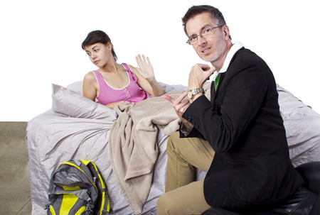 father waking up lazy daughter for school  Stock Photo