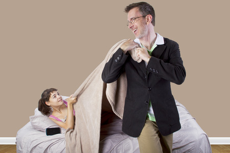 get tired: father waking up young girl in the morning