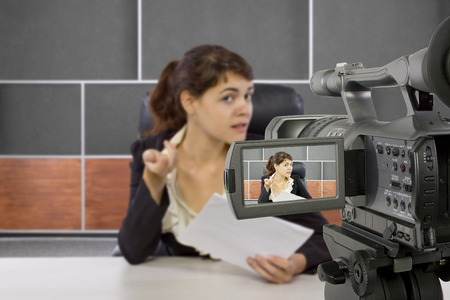 camera view of a female reporter in a news room photo