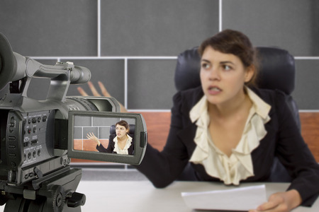newsroom: camera view of a female reporter in a news room Stock Photo