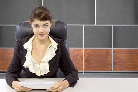 newsroom: young female reporter in a news room set Stock Photo