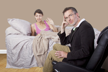 reprimanding: father scolding lazy daughter who wont get out of bed Stock Photo