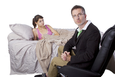 father scolding lazy daughter who wont get out of bed Stock Photo