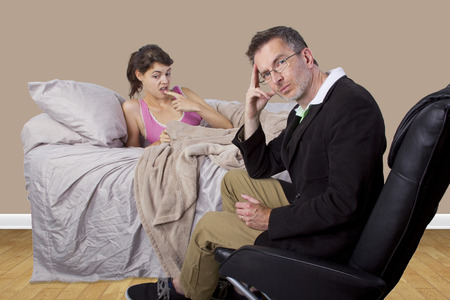father scolding lazy daughter who wont get out of bed Imagens