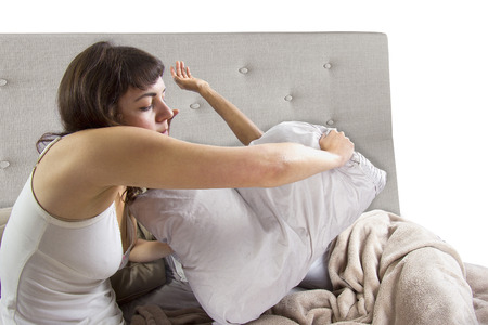 sleep: unable to sleep in bed because of snoring partner Stock Photo