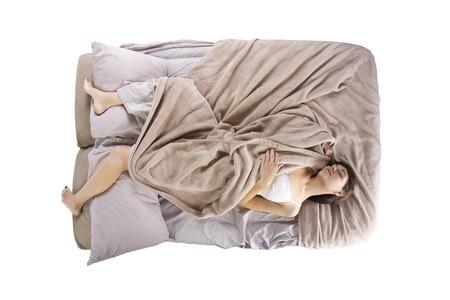 bovenaanzicht van de jonge vrouw in bed niet kunnen slapen Stockfoto