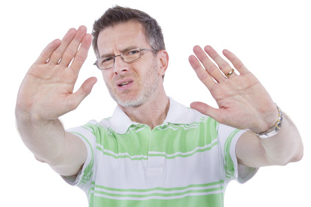 adult male gesturing a stop sign on white background