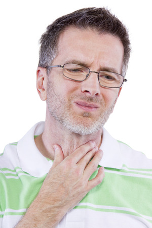 adult male holding painful throat and frowning