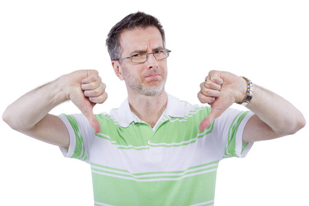 adult man in green shirt with thumbs down gesture photo