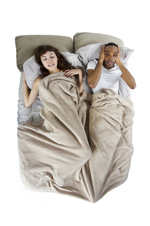 unable to sleep in bed because of snoring partner photo