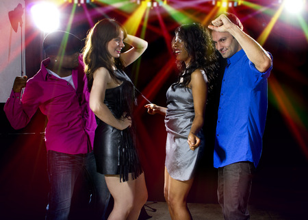 dancing club: fashionable young male and female adults club dancing