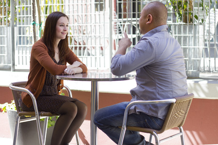 interracial couple meeting on a casual first date outdoors