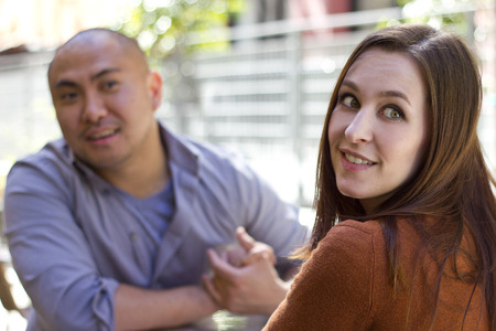 chatty: bored incompatible couple on an outdoor date outdoors Stock Photo