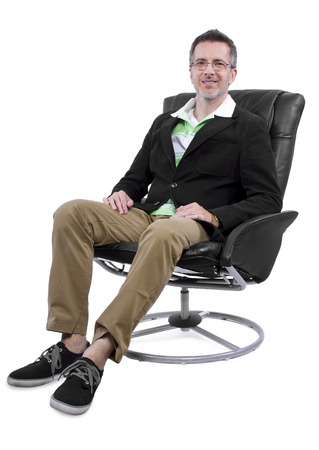 cool middle aged man relaxing with shoes and no socks photo