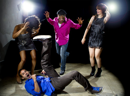 peer pressure: Caucasian man falls but confidently plays cool in a dance club Stock Photo
